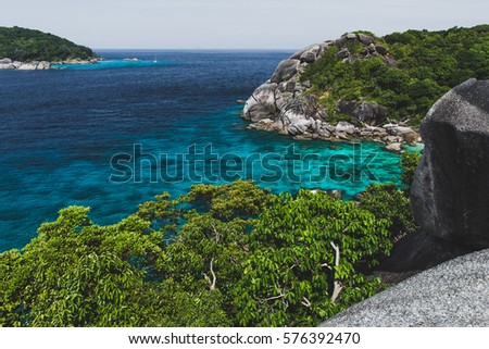 Rocky coast of paradise island with transparent crystal and clear water. Vacation in Similan