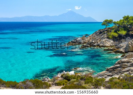 Rocky coastline and a beautiful clear water at Halkidiki Kassandra peninsula in Greece - stock photo
