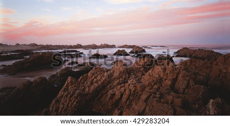 Rocky coastline at sunset. Knysna, Garden Route, Western Cape, South Africa, Africa - stock photo