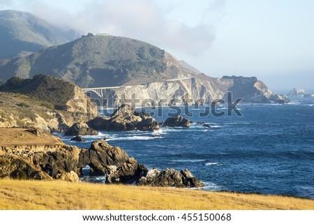 Rocky Creek Bridge in the background in the Big Sur area of Califfornia. - stock photo