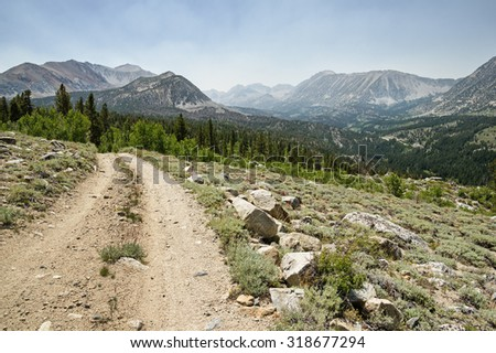 rocky dirt road above Rock Creek Valley in the Sierra Nevada of California - stock photo