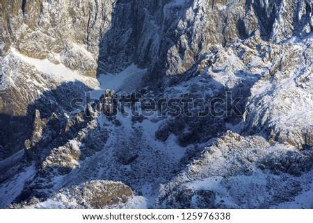 rocky escarpments in western slope of the peak Midi d'Ossau, Ossau Valley, Pyrenees, France - stock photo