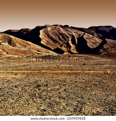 Rocky Hills of the Negev Desert in Israel at Sunset, Vintage Style Toned Picture - stock photo