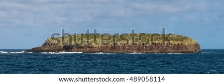 Rocky island in Atlantic Ocean