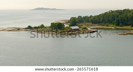 Rocky islands in archipelago of Aland Islands, Finland - stock photo