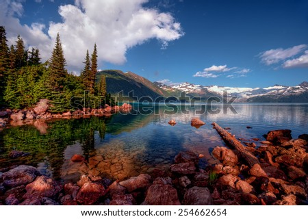 Rocky lake bed in the mountains - stock photo