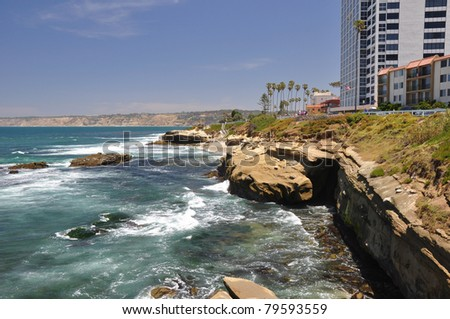 Rocky ledges create many coves along the shoreline in La Jolla, California. - stock photo