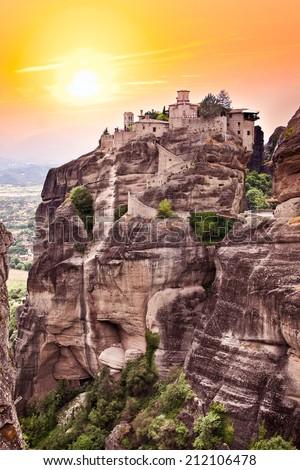 Rocky monastery at Meteora in sunset, Trikala region, Greece. - stock photo