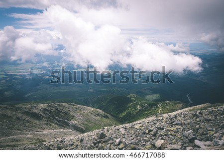 rocky mountain landscape covered with clouds and fog. High Tatra, Slovakia - vintage film effect