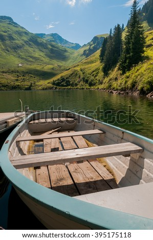 rocky mountain peaks in the background and beautiful reflections on smooth water fascinating nature scene  - stock photo