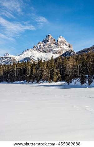 Rocky mountain peaks of Tre Cime over frozen Lake Misurina in the Dolomites, Italian Alps - stock photo