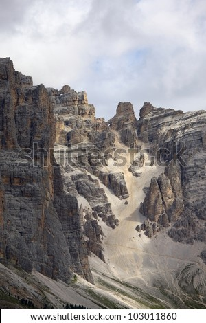 Rocky mountain ridge in the Dolomites - stock photo