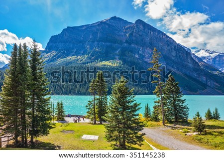 Rocky Mountains, Canada, Banff National Park. Magnificent Lake Louise in the mountains. A great sunny day - stock photo