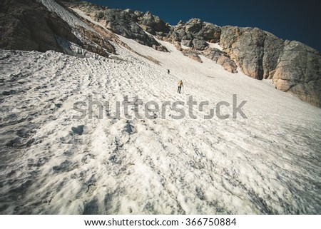 Rocky Mountains Glacier snow with travelers climbing Landscape blue sky Summer Travel scenic aerial view  - stock photo