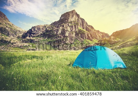 Rocky Mountains Landscape and tent camping Travel Lifestyle concept Summer adventure vacations outdoor - stock photo