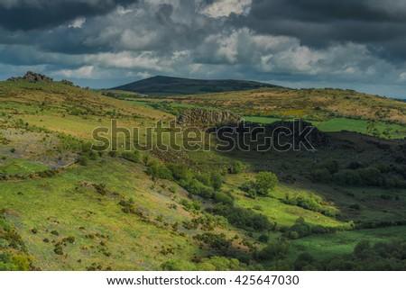 Rocky outcrop hills in Dartmoor, Devon, UK, landscape panoramic vista - stock photo
