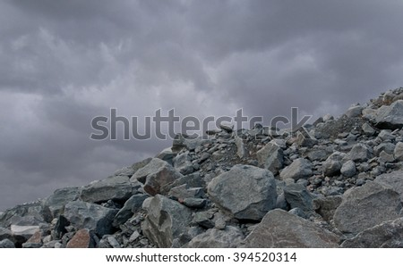 Rocky rocks on the background of the cloudy sky.