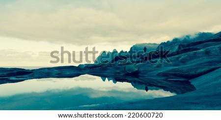 rocky sea coast at viewpoint at Devils teeth, Tungeneset, Senja  - stock photo