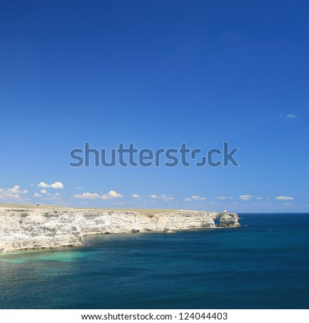 Rocky sea coastline with beautiful blue sky