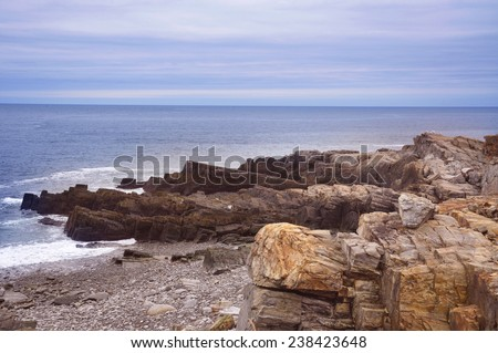 rocky shore by the ocean - stock photo