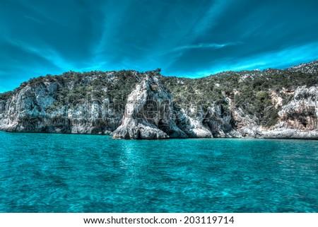 rocky shore in Orosei Gulf. Hdr tone - stock photo