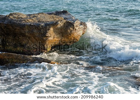 Rocky shore of the Caspian Sea during the storm. - stock photo