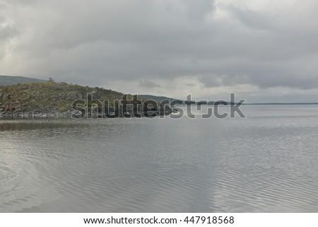 Rocky shore of the lake. Rocks on the shore and on the lake bottom Keta on the Putorana plateau. - stock photo