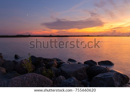 Rocky shore of the sea bay in the quiet evening.
