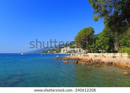 Rocky shore with green vegetation near the Adriatic sea, Opatija, Croatia - stock photo