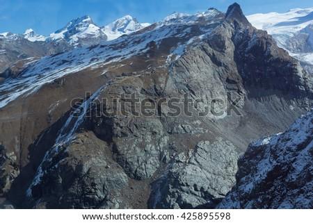 Rocky slopes of the Swiss Alps near Zermatt, Switzerland - stock photo