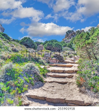 rocky stairs in Costa Paradiso. Processed for hdr tone mapping effect - stock photo