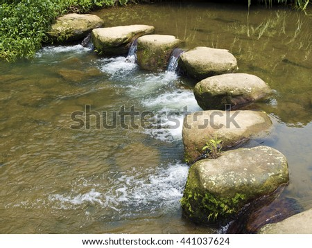 Rocky Stepping Stones Across a Beautiful Rural River