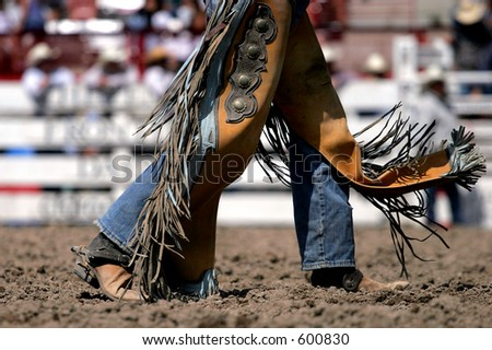 Rodeo cowboy and chaps at a rodeo (shallow focus).