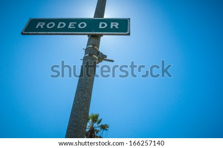 Rodeo Drive Strret sign in Beverly Hills sunlight 2013 - stock photo