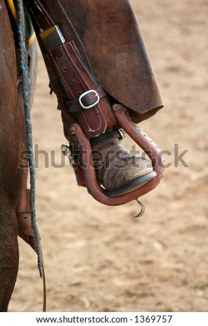 rodeo riders boot and leathers in stirrup