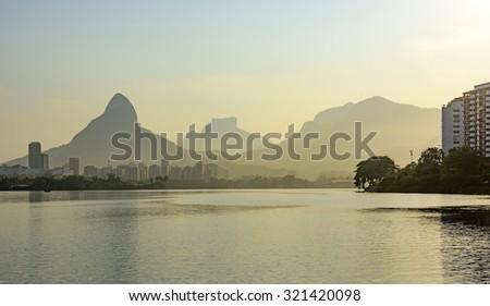 Rodrigo de Freitas Lagoon landscape at dusk where will be held the 2016 Olympic Games rowing events in Rio de Janeiro - stock photo
