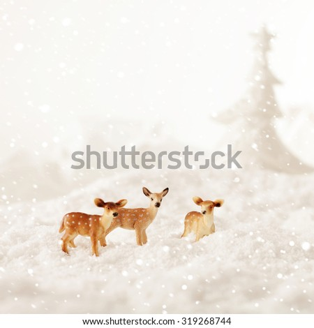 roe deer group in winter snow - christmas decoration - stock photo