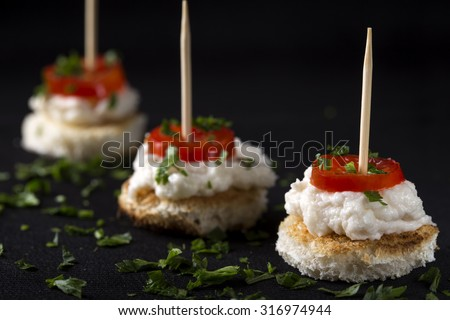 Roe salad appetizer with bread and tomatoes - stock photo
