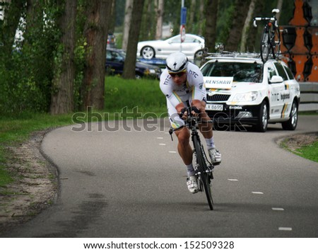 ROERMOND, HOLLAND - AUGUST 12 :Mark Renshaw from team  HTC High road during time trial of Eneco cycling tour August 12, 2011 in Roermond, Holland.  - stock photo