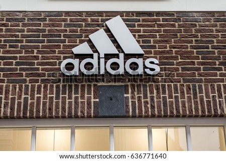 Roermond Netherlands 07.05.2017 Logo of the adidas brick house Store in the Mc Arthur Glen Designer Outlet shopping area