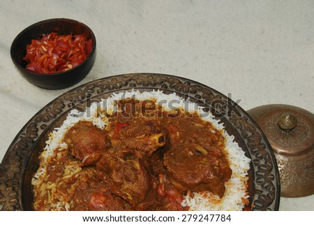 Rogan josh made of lamb or goat cooked in tomatoes, oil and fresh spices - stock photo