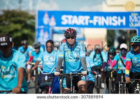 "ROI-ET AUGUST 16 : Unidentified Cyclist in prepared ""Bike For Mom"", event show respected to Queen of Thailand on August 16, 2015, ROI-ET, Thailand. record to Guinness Book of World Records."