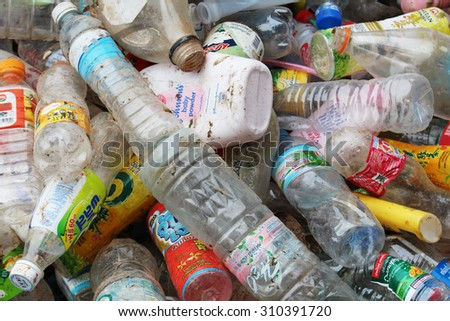 ROI ET, THAILAND - AUGUST 1, 2015: Plastic bottles and beverage cans on a recycle factory in Roi Et, Thailand. The plastic can will be sorted for recycling.