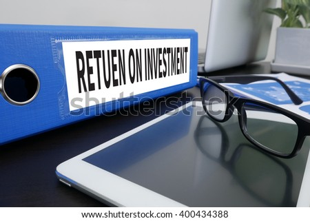 Roi Return On Investment Analysis Concept Office folder on Desktop on table with Office Supplies. ipad - stock photo