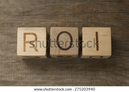 ROI - Return on Investment - letters on wooden background - stock photo