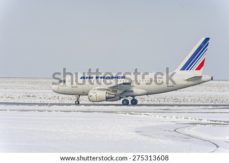 ROISSY, FRANCE - DECEMBER 20, 2010 : Airliner Airbus A318 from Air France waiting for take off in the snow - stock photo