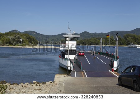 ROLANDSECK, GERMANY - AUGUST, 31. A ferry carries persons and cars across the River Rhine at Rolandseck (City Remagen, Germany, Rhineland-Palatinate) on August 31, 2015.