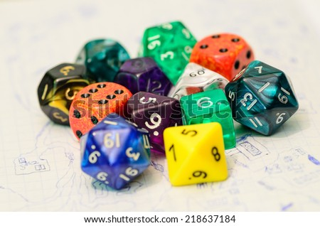 role playing dices lying on sketch map - stock photo