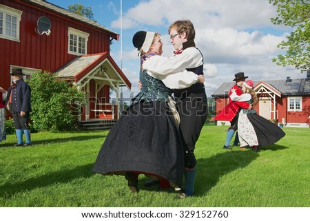 ROLI, NORWAY - JUNE 25, 2013: Unidentified people wearing historical costumes perform traditional dance in Roli, Norway. - stock photo