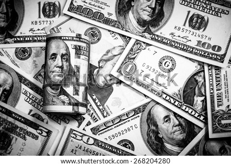 Roll background of hundred  dollars notes with black and white color.Focus on roll of 100 dollar banknote - stock photo